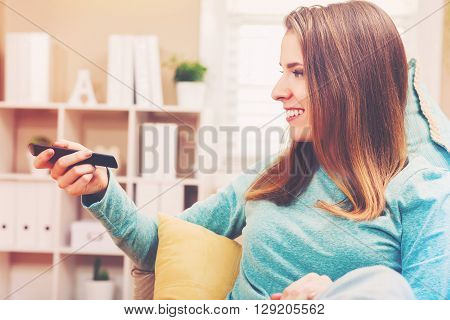 Young Woman Watching Tv In Her House
