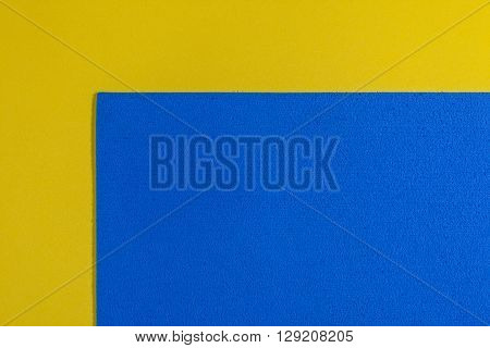 Eva foam ethylene vinyl acetate sponge plush blue surface on lemon yellow smooth background
