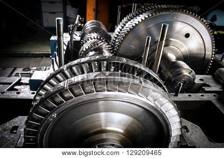 A wheel of a small steam turbine.