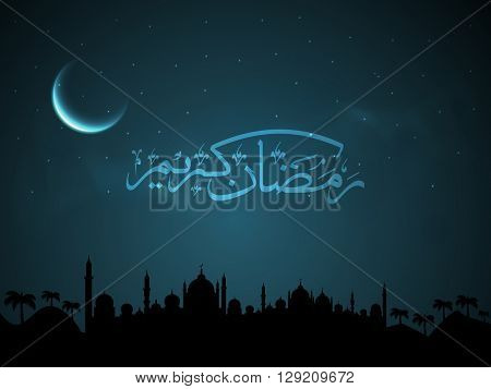 Arabic Islamic Calligraphy of text Ramadan Kareem with beautiful Mosque silhouette on moon light night background.