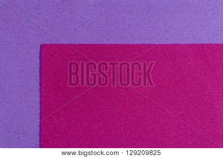 Eva foam ethylene vinyl acetate pink surface on light purple sponge plush background