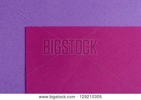 Eva foam ethylene vinyl acetate smooth pink surface on light purple sponge plush background