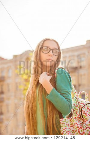 Pretty Long-haired Woman In Glasses With Backpack Walking On The Tour