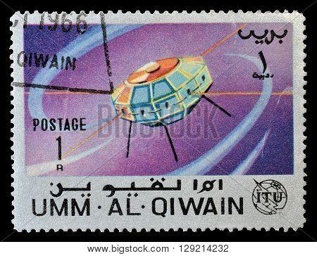UMM AL QIWAIN - CIRCA 1966 : Cancelled postage stamp printed by Umm Al Qiwain, that shows Satellite.