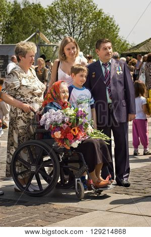 Kyiv, Ukraine - May 8, 2009: Veteran woman on a wheelchair with her family during Victory Day celebration at the Museum of The History of Ukraine in World War II in Kyiv