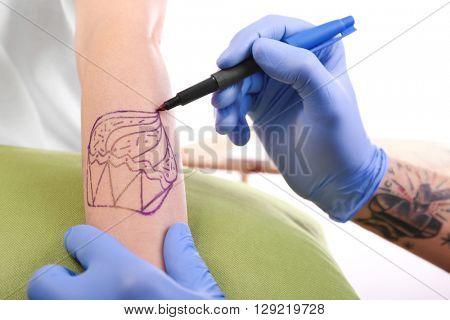 Process of making tattoo, closeup