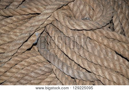 A closeup of a pile of looped heavy rope