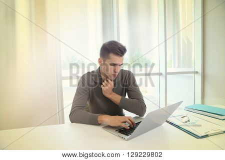 Businessman in meting room working on laptop computer