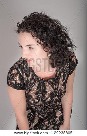 Young Model In Her Mid Twenties In A Black Dress.