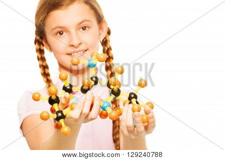 Portrait of teenage schoolgirl with molecular structure in her hands, isolated on white background