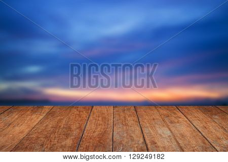 Blue sunset sky and wood floor background, stock photo