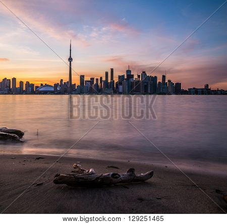 TORONTO CANADA - 7TH JUNE 2015: Toronto Skyline during a colorful Sunset. Lots of buildings can be seen.