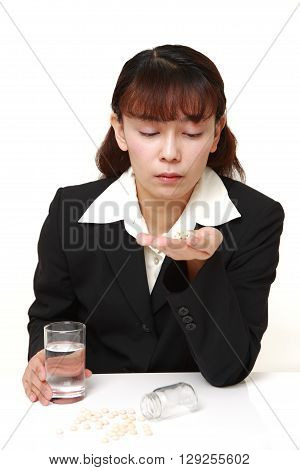portrait of Asian businesswoman suffers from melancholy on white background