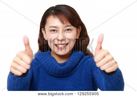 portrait of Asian woman with thumbs up gesture on white background
