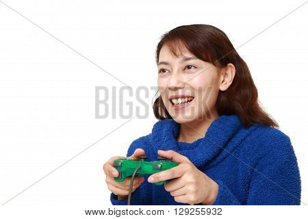 portrait of Asian woman enjoying a video game on white background