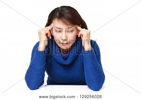 portrait of woman suffers from headache on white background