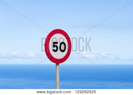 Fifty traffic sign. 50 miles per hour speed limit sign round red