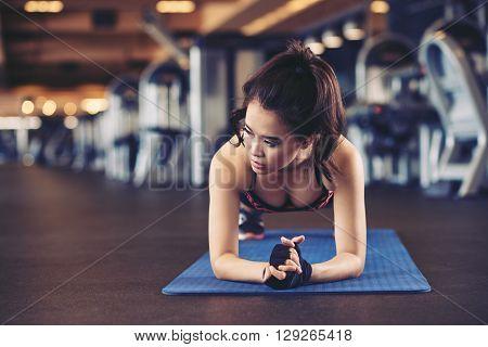 Pretty fit Vietnamese girl in plank position