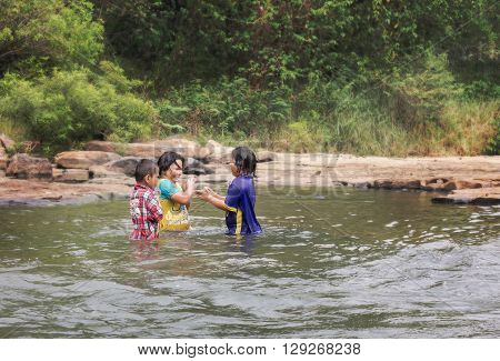 PHITSANULOK THAILANDFEBRUARY 2016 Group of childern play happily in water at KHEK RIVER