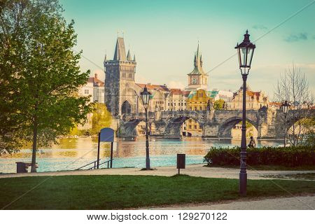 Prague, Czech Republic skyline with historic Charles Bridge and Vltava river as seen from spring park. Vintage