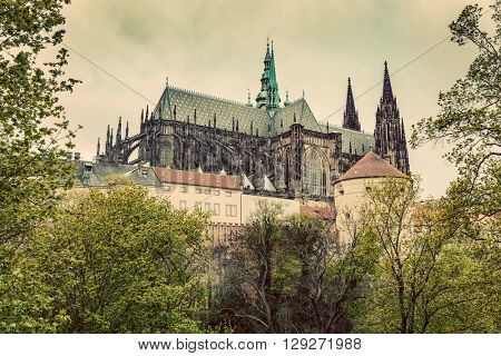 Prague Castle with St. Vitus Cathedral, Hradcany, Czech Republic. Vintage, cloudy day