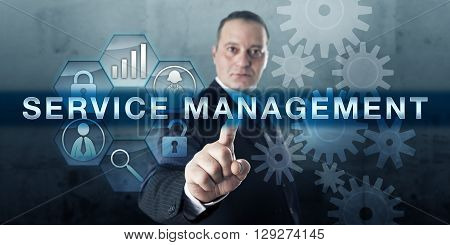 Entrepreneur pressing SERVICE MANAGEMENT on a virtual touch screen interface. Business concept for a service strategy focussed on fulfillment operations and optimization of customer service quality.