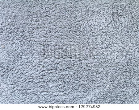 Light gray fluffy polyester fleece fabric background