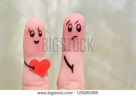 Finger art of a couple. The concept is not shared love. Woman confessed her love, the man does not love her.