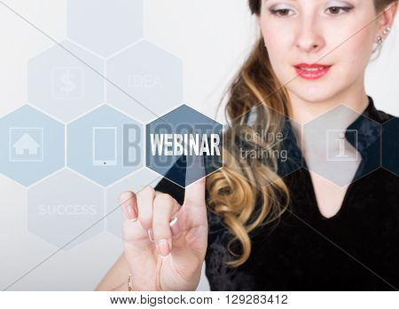 technology, internet and networking concept. beautiful woman in a black business shirt. woman presses webinar button on virtual screens. Online education.