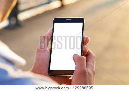 Man uses his Mobile Phone outdoor close up