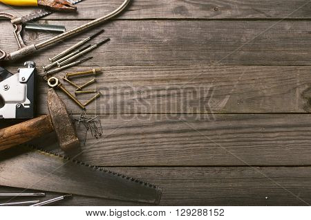 old tools on a wooden table with space for your text top view