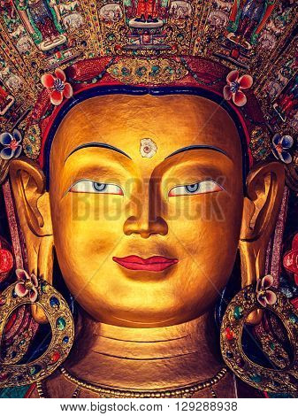 Vintage retro effect filtered hipster style image of Maitreya Buddha statue face close up in Thiksey Gompa. Ladakh, India