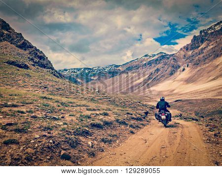 Vintage retro effect filtered hipster style image of motorcycle bike on mountain road in Himalayas. Spiti Valley, Himachal Pradesh, India