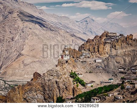 Vintage retro effect filtered hipster style image of Dhankar gompa Buddhist monastery on cliff and Dhankar village in Himalayas, Dhankar, Spiti valley, Himachal Pradesh, India