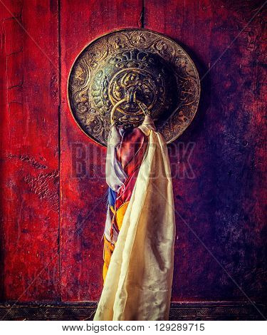 Vintage retro effect filtered hipster style image of door handle of gates of Thiksey gompa (Tibetan Buddhist monastery). Ladakh, India