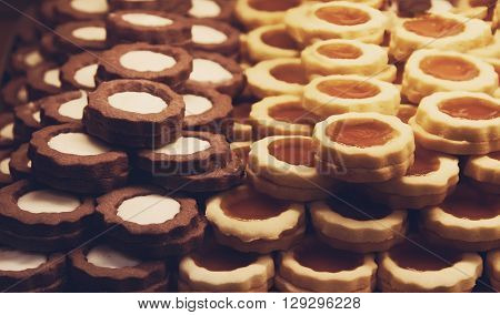 Chocolate cookies and almond cookies, sweets in the italian confectionery poster