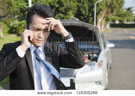 stress business man calling for help with car broken concept