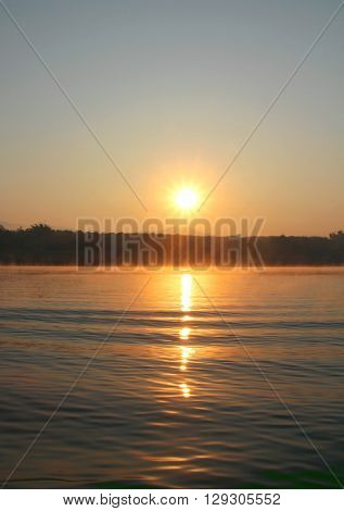 Misty tropical sunset on lake in Mae Ngad Dam and Reservoir Chiang Mai Thailand poster