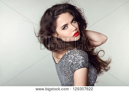 Beauty Portrait Of Beautiful Brunette Woman With Red Lips And Curly Hair Style In Party Dress Isolat