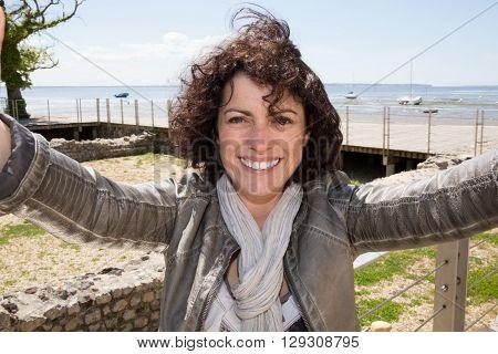 Woman cheerful at the beach doing a selfie