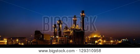 Gas turbine electrical power plant at dusk with light panorama view