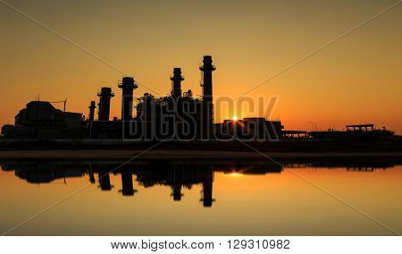 Gas turbine electrical power plant with sunset at dusk