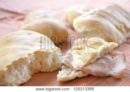 wedge of focaccia bread stuffed with mortadella