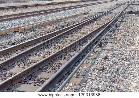 railway road line with bolt and nut on wood railroad sleepers
