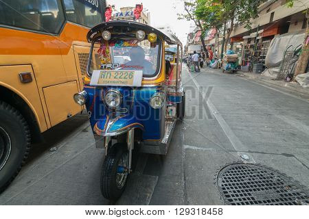 Bangkok Thailand - March 6 2016 : Thai TukTuk taxi running on the road in Bangkok Thailand.