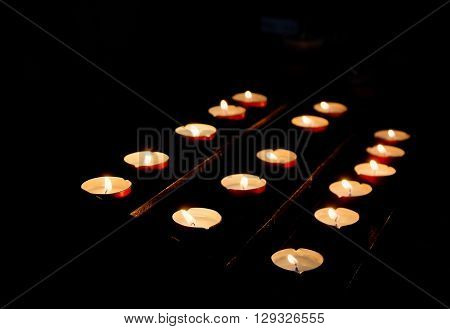 Row of candles in church Venice Italy