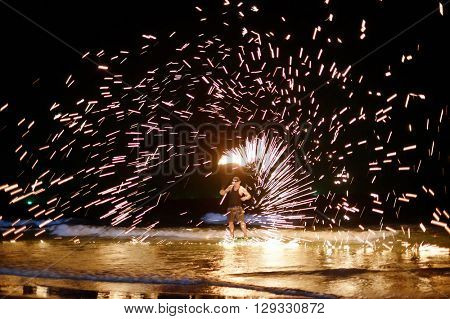 unidentified Firestarter performing amazing fire show at Koh Samed Samet island Thailand