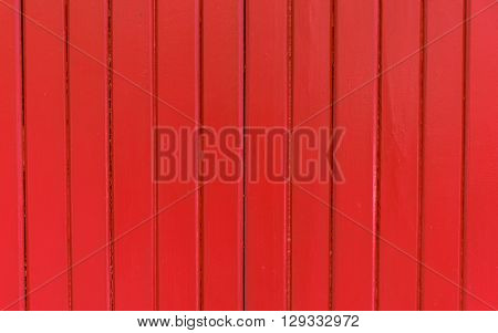Clos up red painted corrugated wood door