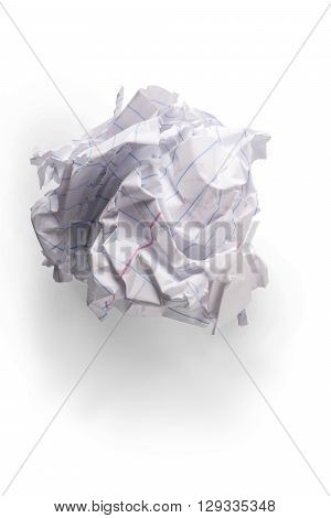 A piece of crumpled up notebook paper in a ball on white with shadow.