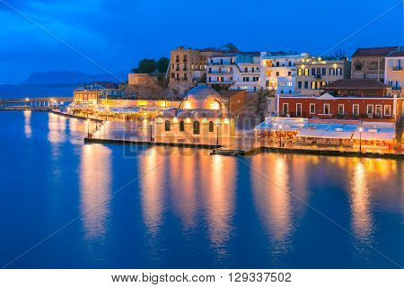 Picturesque panoramic view of Venetian quay of Chania with Kucuk Hasan Pasha Mosque during twilight blue hour, Crete, Greece poster